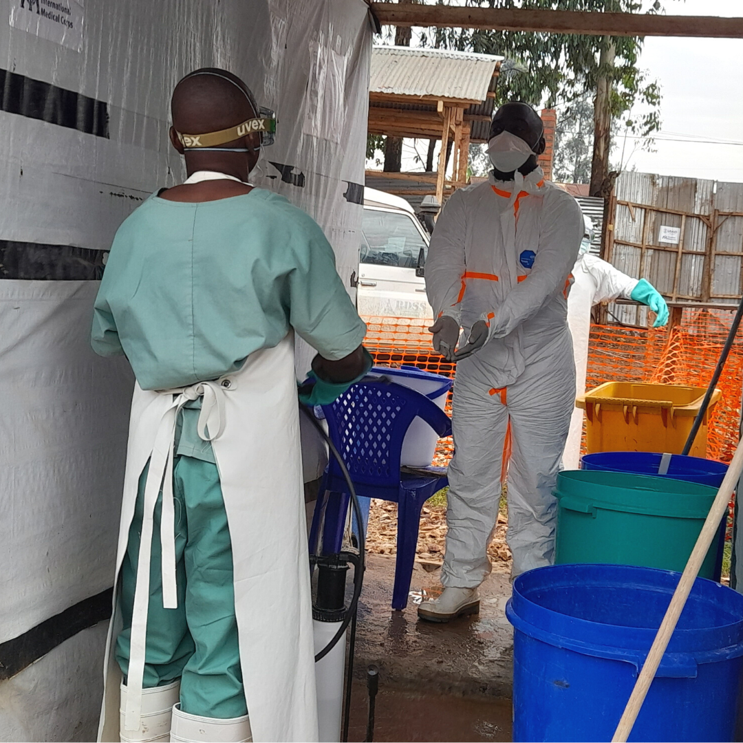 Kakule Dade disinfecting a health staff who treated patients at Katwa ETC in Butembo North- Kivu province in the DRC.