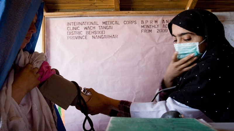 International Medical Corps staff checking blood pressure at a clinic in Nangarhar province
