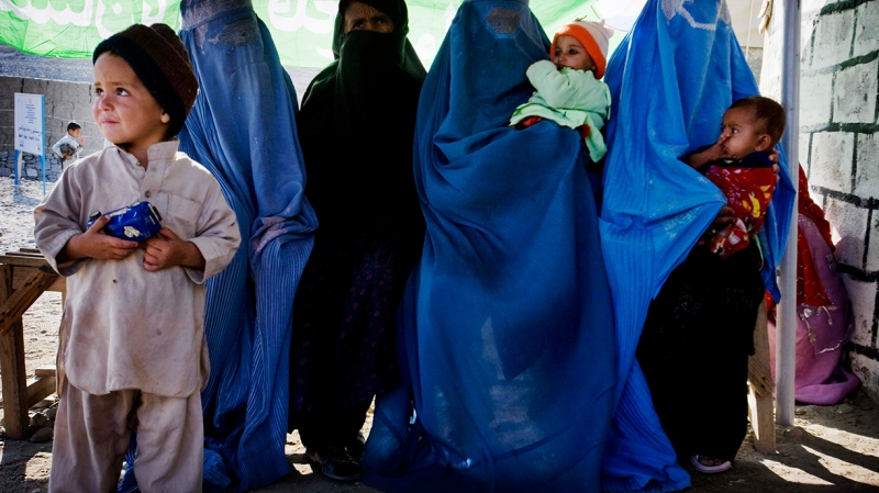 Women and children waiting outside a primary health care clinic in Jalalabad