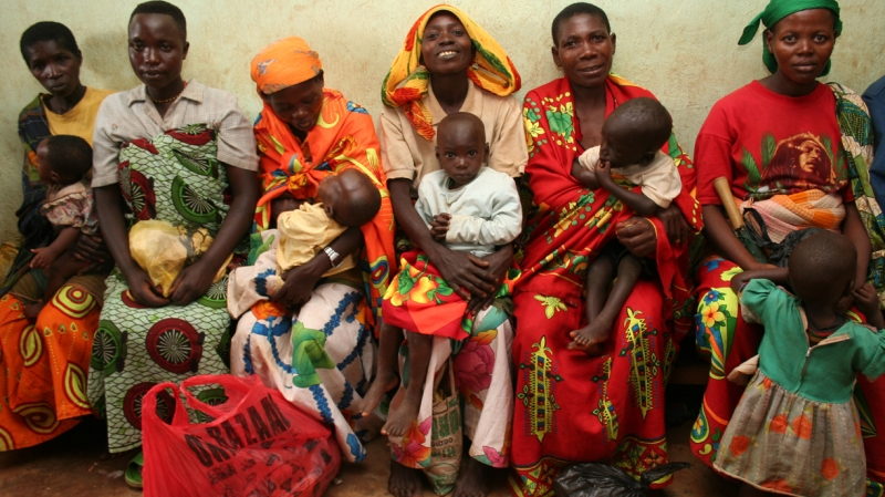 A group of women in Burundi wait for their children to be measured for signs of malnutrition.