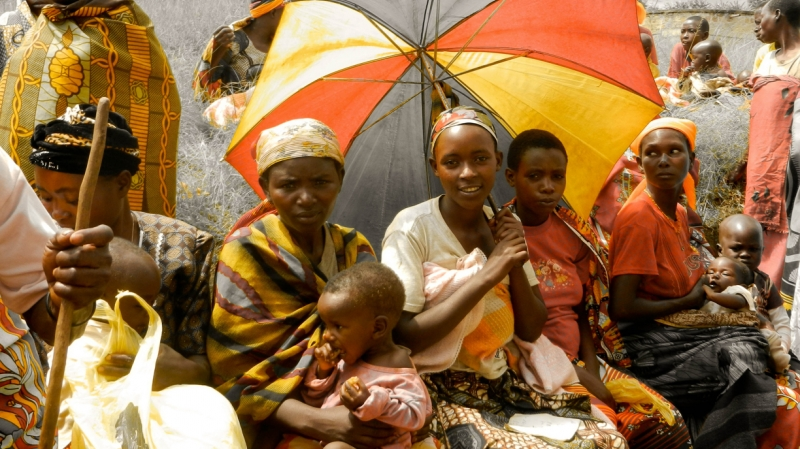 Women and their children wait for nutritious food distributed by International Medical Corps