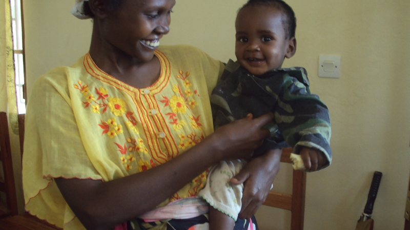Juma and his mother after he received successful treatment