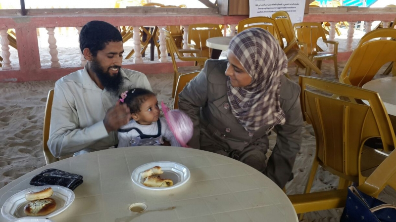 Ala'a with her husband and youngest child at the International Medical Corps supported centre in Gaza