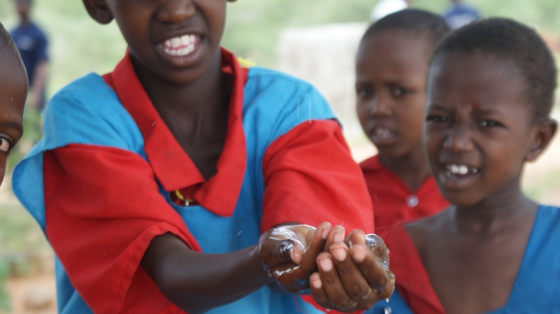 A girl washing her hands in clean water