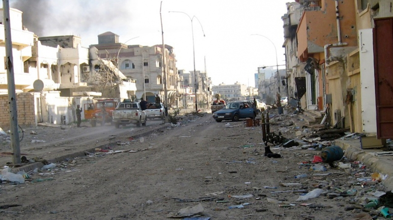 Rubble covers a street in Libya