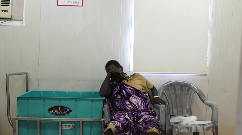 Jennifer's mother waits outside the operating room for news about her young daughter
