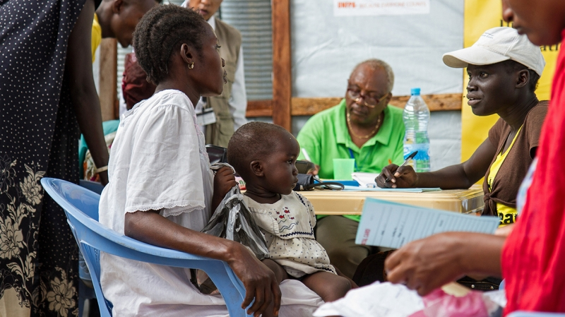 A mother gets registered for her antenatal consultation at our one of our reproductive health clinics in Juba.