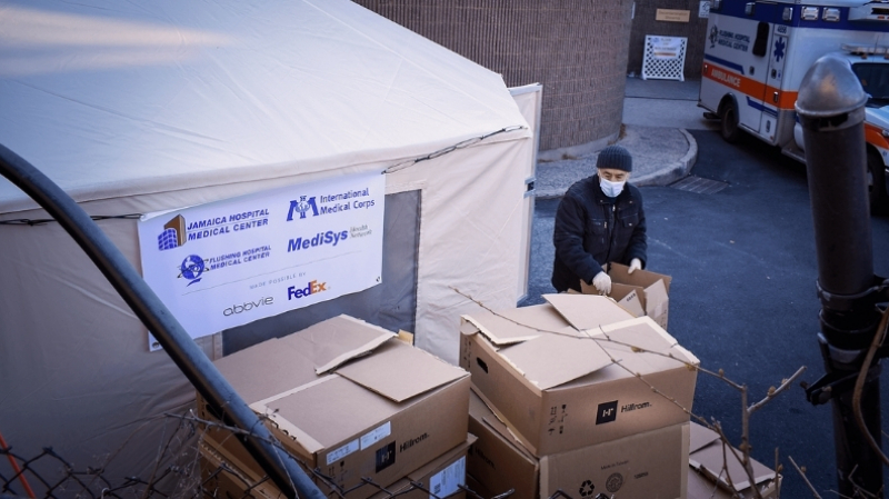 International Medical Corps' team processes a delivery to Jamaica Medical Center of COVID-19 supplies, including gowns, nitrile gloves, face shields and face masks. To date, International Medical Corps has delivered 4 million items of PPE across the US.
