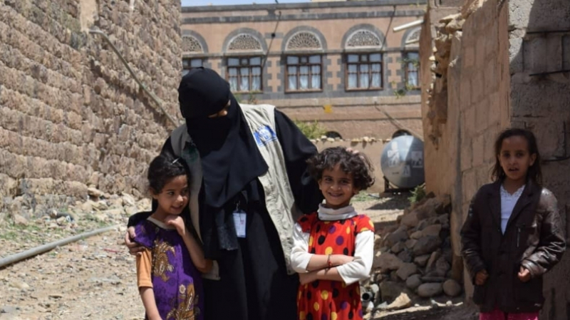 In a photo taken before the COVID -19 pandemic reached Yemen, Dr Khaled talks with young girls during a cholera-awareness event in Sana'a Governorate's Sanhan District.