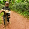 A boy in the village of Gashoho plays whilst his mother joins a community education session on preventing malnutrition