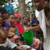A health worker raising awareness about the benefits of handwashing with soap
