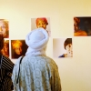 Visitors to a cultural centre admire Vincent Trumeau's stunning portraits.. Credit: Vincent Tremeau/Oxfam