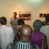 Vincent Trumeau talks about his photographs to guests as one of the many photography exhibits.