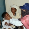 A female doctor provides a check up for a young boy in Sindh province of Pakistan