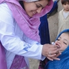 An International Medical Corps doctor administers an oral polio vaccination to a young girl in Pakistan