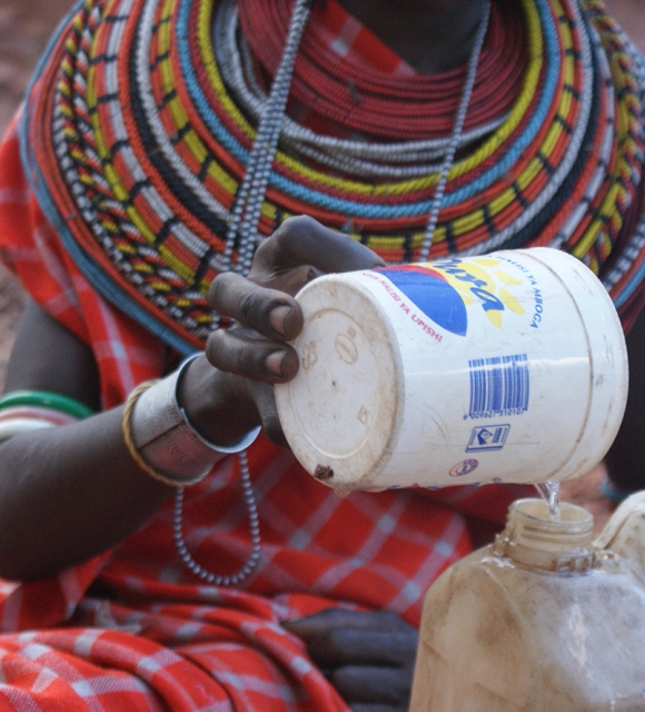 A woman collecting water in Samburu Kenya tile