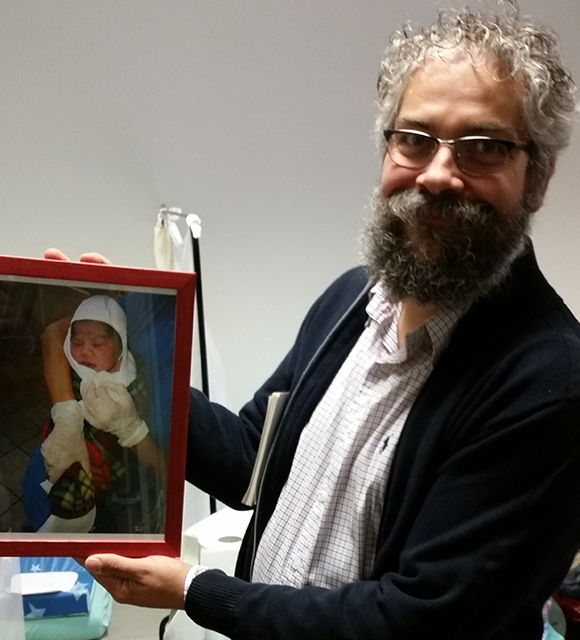 Tomas shows a picture of baby Fatima