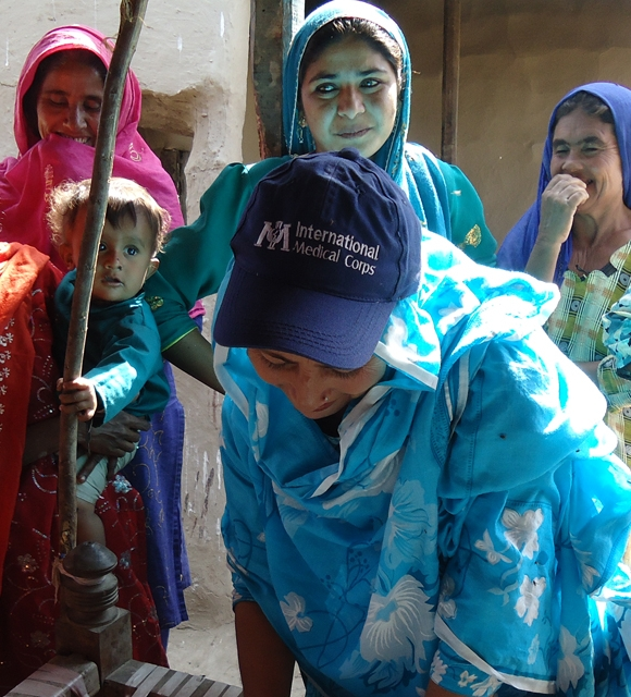 Distributing blankets and medicines following Pakistan floods
