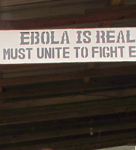 A sign warns people that Ebola is real in Sierra Leone