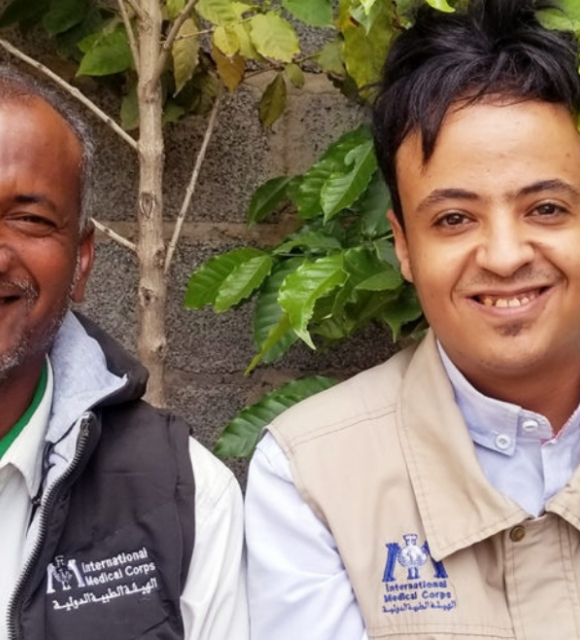 Fayad Al-Derwish (right), Senior Officer for Water, Sanitation and Hygiene (WASH) programming in Yemen's southern governorates, with Mohammed Mahyoub, an International Medical Corps Community Health Worker, who now lives and works at the Al-Shorman IDP Ca